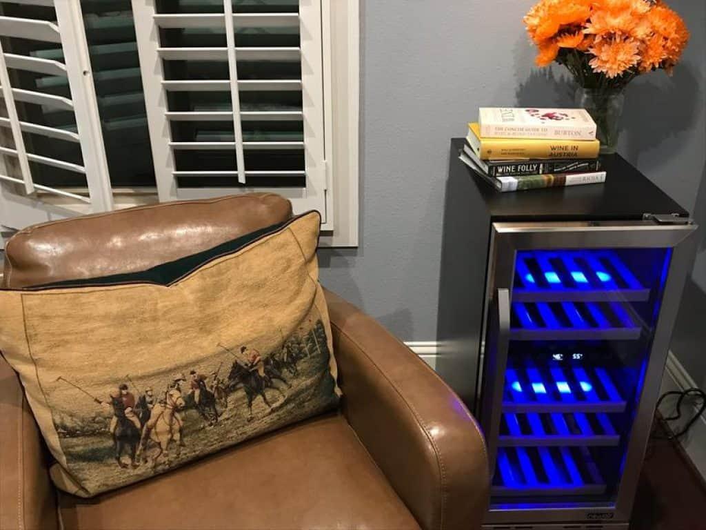 "NewAir 15"" Built-in 29 Bottle Dual Zone Wine Fridge beside my favorite chair"
