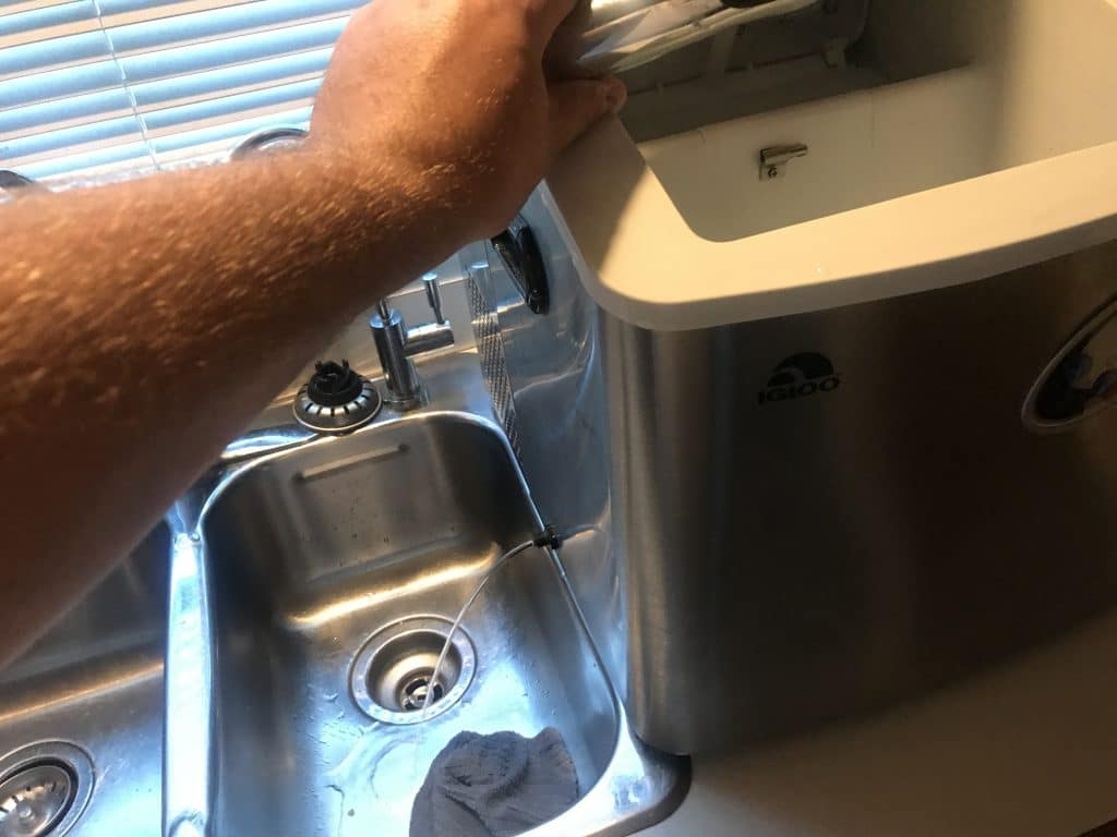 Drain the ice maker again while you are rinsing